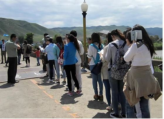 Chinese tourists at a destination in North Korea (Yonhap)