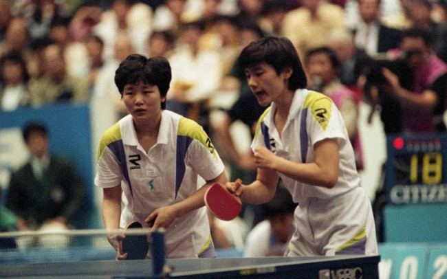Hyun Jung-hwa, right, plays alongside North Korean table tennis player Li Pun-hui at the 1991 World Championships in Chiba, Japan. (Provided by Hyun Jung-hwa)
