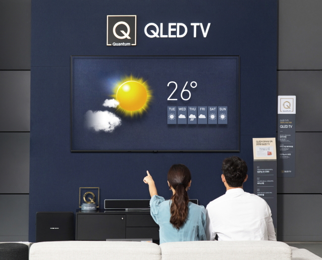 "QLED TV ZONE -- The newly furbished QLED TV Zone at Samsung Digital Plaza in Yongin, Gyeonggi Province, is displayed Sunday. Samsung Electronics has installed the QLED TV experience space at some 300 Samsung Digital Plaza locations nationwide to showcase the premium TVs' superior display quality as well as unique features such as the ""magic screen"" and ""magic cable."" (Samsung Electronics)"