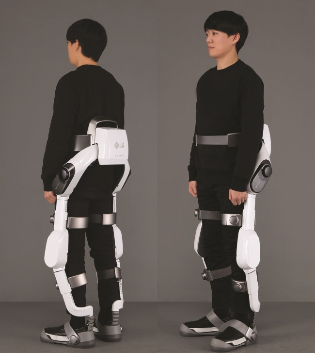 A model tries on a CLOi SuitBot. (LG Electronics)