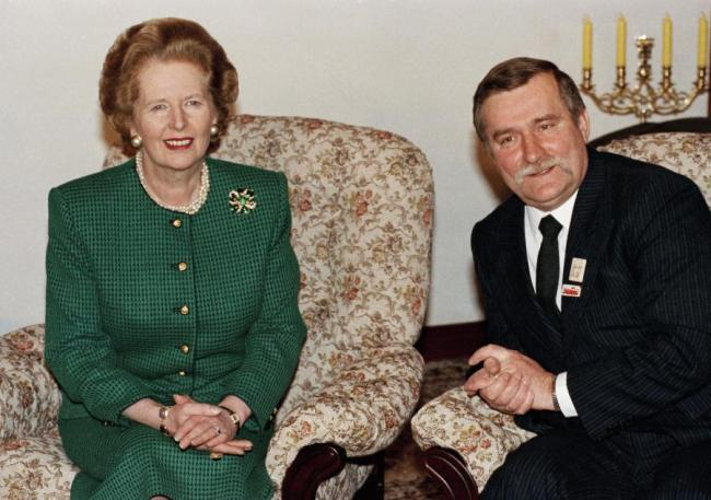 The late Margaret Thatcher (left) with Lech Walesa in Poland in 1988 (Martin Cleaver/AP)