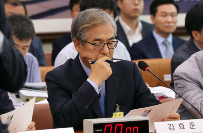 Kim Hyo-joon, cheif of BMW Korea, attends a hearing on the BMW fires by the National Assembly's Land, Infrastructure and Transport Committee at the National Assembly on Tuesday. (Yonhap)