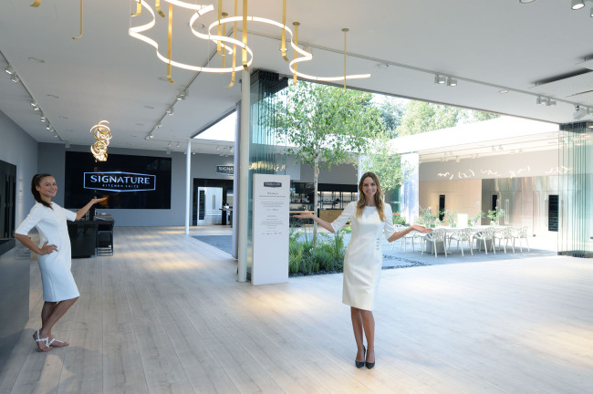 Models pose in front of LG's Signature Kitchen Suite at IFA 2018 in Berlin. (LG Electronics)