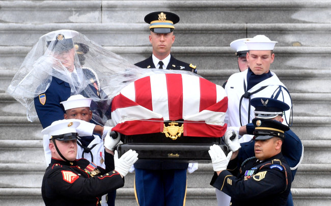 The casket of Senator John McCain, R-Ariz., is carried down the steps of the US Capitol in Washington, US September 1, 2018. (Reuters)