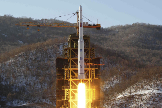 Footage from the KCNA news agency shows the Unha-3 rocket launching at North Korea's West Sea Satellite Launch Site in 2012 (Yonhap)