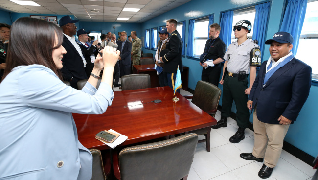 Foreign ambassadors to South Korea take photos during a visit to the Demilitarized Zone on Friday.(The Ministry of Culture, Sports and Tourism)