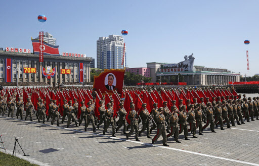 North Korean soldiers march with a float showing late North Korean leader Kim Il Sung during a parade for the 70th anniversary of North Korea`s founding day in Pyongyang, North Korea, Sunday, Sept. 9, 2018. North Korea staged a major military parade, huge rallies and will revive its iconic mass games on Sunday to mark its 70th anniversary as a nation. (AP)