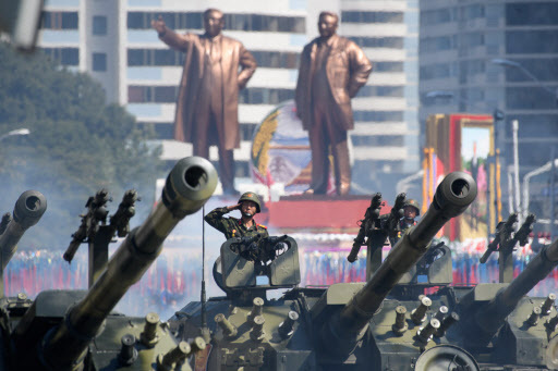 Korean People`s Army (KPA) soldiers stand in formation prior to a military parade and mass rally on Kim Il Sung square in Pyongyang on September 9, 2018. (AFP)