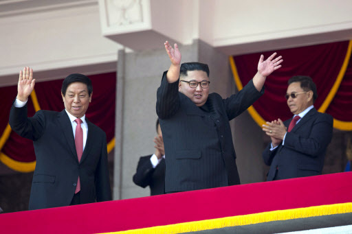 North Korean leader Kim Jong Un, right, raises his hands as he waves with China`s third highest ranking official, Li Zhanshu, at left during a parade for the 70th anniversary of North Korea`s founding day in Pyongyang, North Korea, Sunday, Sept. 9, 2018. (AP)