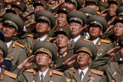 Korean People`s Army (KPA) soldiers salute as they watch a mass rally on Kim Il Sung square in Pyongyang on September 9, 2018. (AFP)
