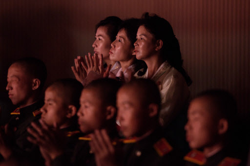 Audience members watch as performers take part in a concert at the Pyongyang Indoor Stadium on September 8, 2018. (AFP)