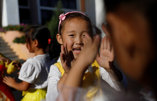 Toddlers sing at a kindergarten for farmer`s children employed at a cooperative farm during a government organised visit for foreign reporters ahead of 70th anniversary of North Korea`s foundation in Pyongyang, September 8, 2018. (REUTERS)