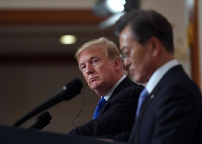 In a file photo taken on Nov. 7, 2017, US President Donald Trump and South Korea`s President Moon Jae-in hold a joint press conference at the presidential Blue House in Seoul, South Korea. (Reuters)