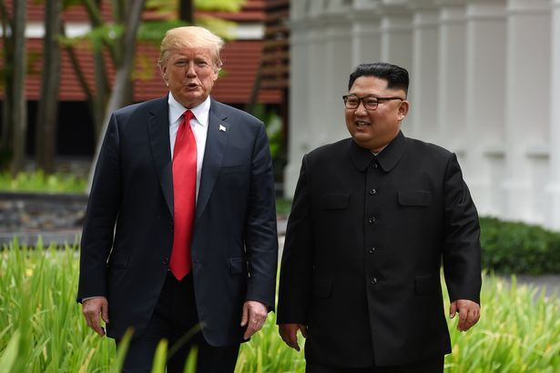 US President Donald Trump and North Korean leader Kim Jong-un walk after lunch at the Capella Hotel on Sentosa island in Singapore June 12. (Reuters)