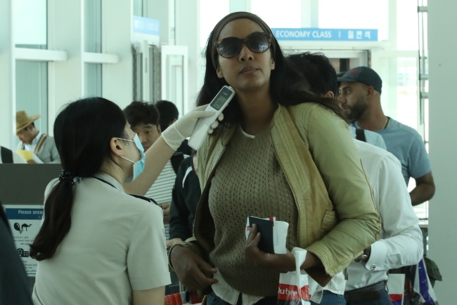 Travellers are being inspected for fever upon their arrival at South Korea`s Incheon International Airport. (Yonhap)