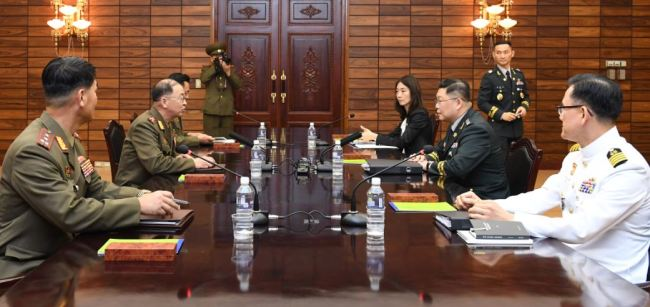 South Korean and North Korean officials hold working-level military talks at the truce village of Panmunjom on Sept. 13, in this photo provided by Seoul's defense ministry. (Yonhap)