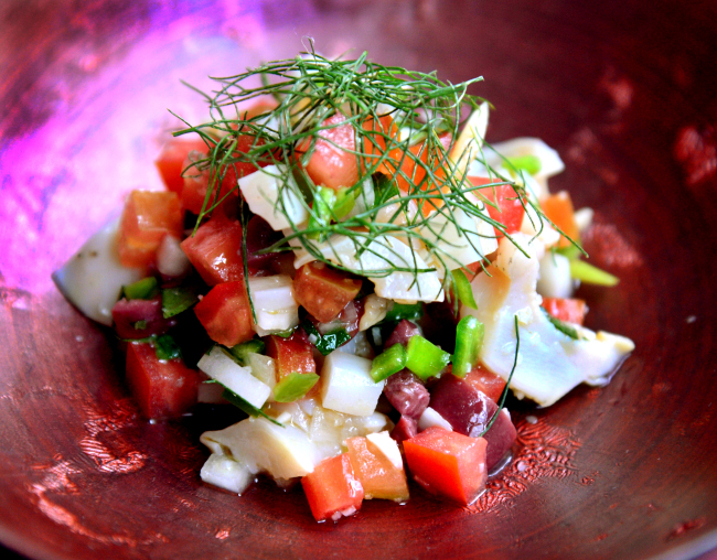 Fragrant shiso and fennel add an aromatic layer to Ithaca's sous-vide whelk, lotus root and tomatoes. (Park Hyun-koo/The Korea Herald)