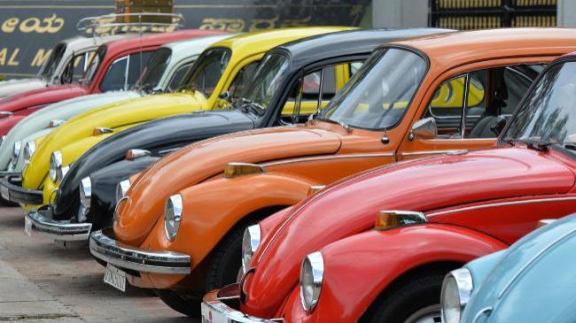 Vintage Volkswagen Beetle cars are parked in a row. (AFP)