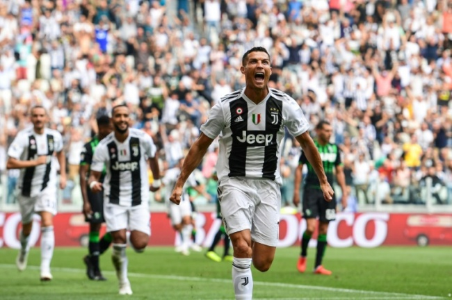 Double delight: Cristiano Ronaldo scored his first goals for Juventus in a 2-1 over Sassuolo in Turin. (AFP)