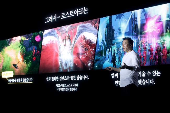 """SMILEGATE SHOWCASES 'LOST ARK' -- Smilegate RPG CEO Jee Won-gil introduces the company's latest massively multiplayer online role-playing game, """"Lost Ark,"""" during a media event in Seoul on Monday. Smilegate is accepting preorders for """"Lost Ark"""" until Nov. 5. The game will officially be released Nov. 7. (Yonhap)"""