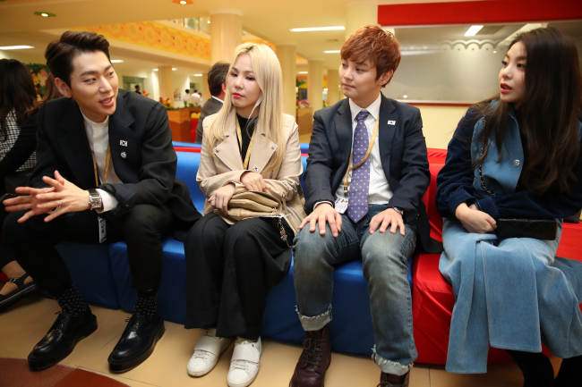 From left: K-pop artist Zico, Ali, magician Choi Hyun-woo, and singer Ailee at Okryu Children's Hospital. (Joint Press Corps)