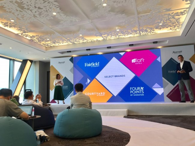 Peggy Fang Roe (left), chief sales and marketing officer, and Mike Fulkerson, vice president of Asia-Pacific brand and marketing for Marriott International, speak at a press conference held Wednesday at Marriott Seoul Botanic Park. (Im Eun-byel / The Korea Herald)