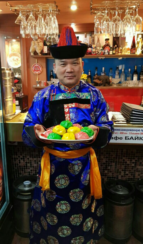 Viktor Kim, who runs Baikal restaurant with his partner, presents Mongolian-Buryat dumplings while wearing traditional Mongolian buryat costume. (Viktor Kim)