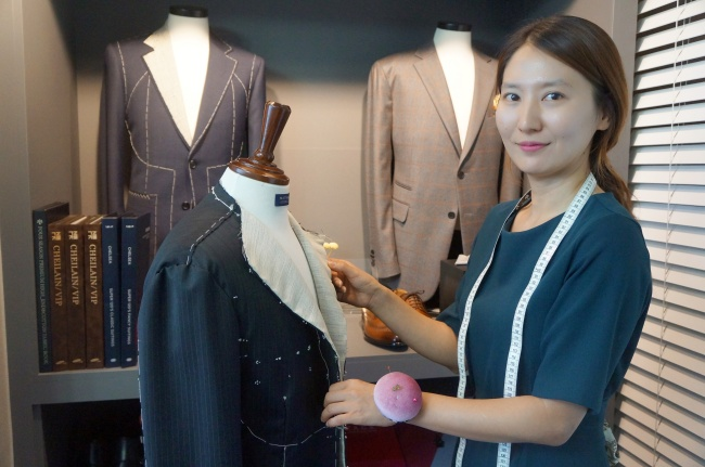 Tailor Kang Ae-wan poses for photos before an interview with The Korea Herald at her tailor shop Matthew, in Bundang, southeast of Seoul. (Im Eun-byel/The Korea Herald)