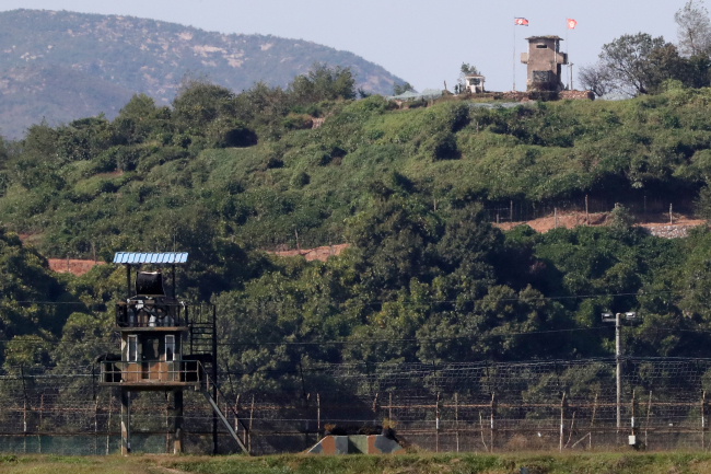 Two Koreas` guard posts stand each other across the DMZ. Yonhap