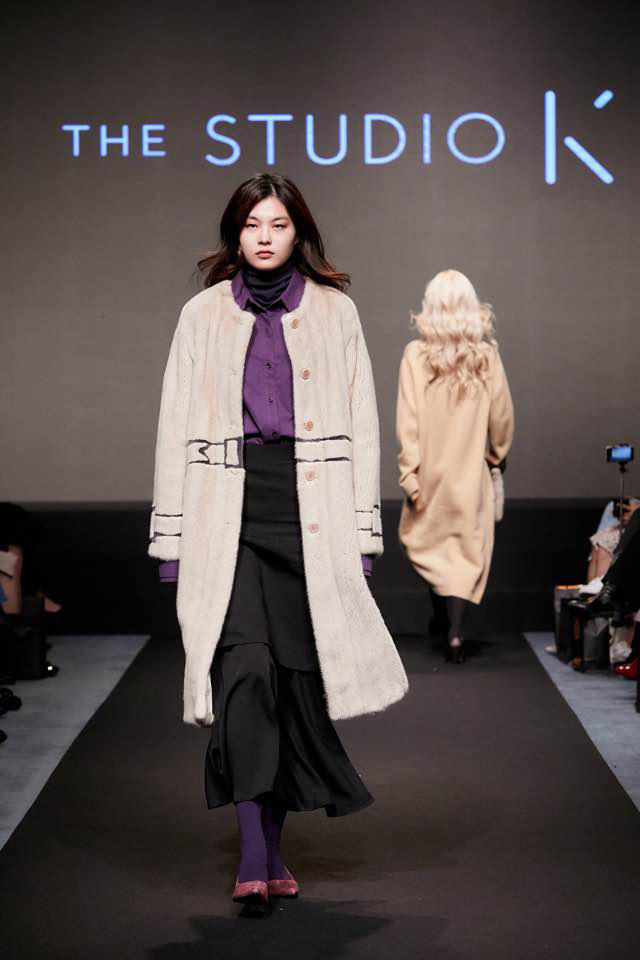 The Studio K's designer Hong Hye-jin participated as a guest designer in Asia Remix. A model walks down the runway in a fur coat designed by Hong. (IFF)