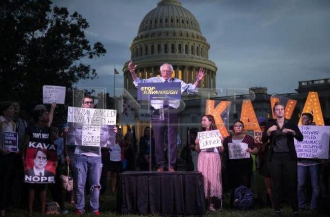 US Sen. Bernie Sanders (I-VT) speaks to protestors rallying against Supreme Court nominee Judge Brett Kavanaugh on Capitol Hill, Oct. 4, in Washington, DC. (AFP)