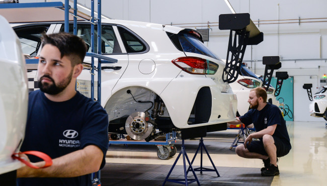 Engineers work on racing cars for WTCR competitions at Hyundai Motorsport's workshop in Alzenau, Germany. (Hyundai Motor)