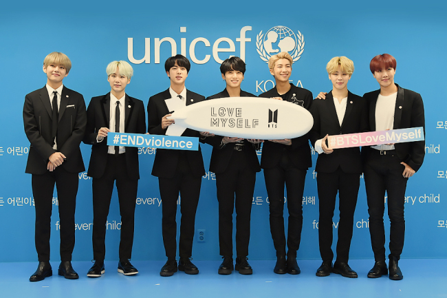 "Members of BTS promote the ""Love Myself"" campaign. (Official website of ""Love Myself"")"