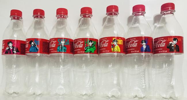 Kim's proud collection of BTS Coca-Cola bottles