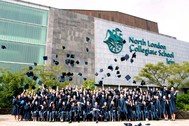North London Collegiate School Jeju's class of 2018 throw their graduation caps into the air. (North London Collegiate School Jeju)