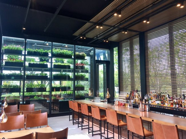 JW Marriott Seoul's Mobo Bar grows herbs at an instore greenhouse for drinks and food. (Im Eun-byel / The Korea Herald)