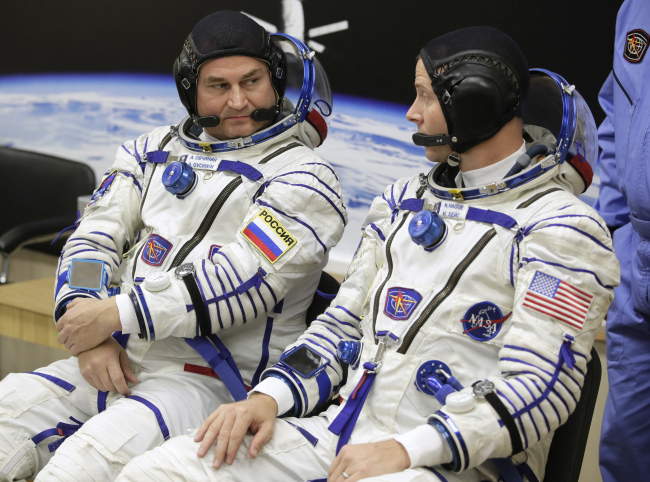 US astronaut Nick Hague, right and Russian cosmonaut Alexey Ovchinin, member of the main crew of the expedition to the International Space Station (ISS), speak prior to the launch of Soyuz MS-10 space ship at the Russian leased Baikonur cosmodrome, Kazakhstan, Thursday, Oct. 11, 2018.