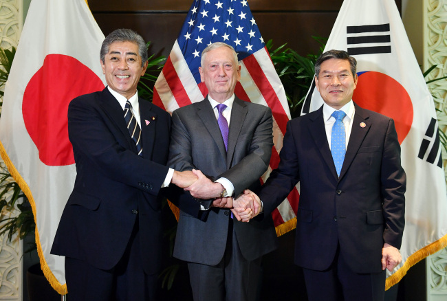 From right: South Korea`s Defense Minister Jeong Kyeong-doo, US Defense Secretary James Mattis and Japanese Defense Minister Takeshi Iwaya pose for a photo. (Ministry of Defense)
