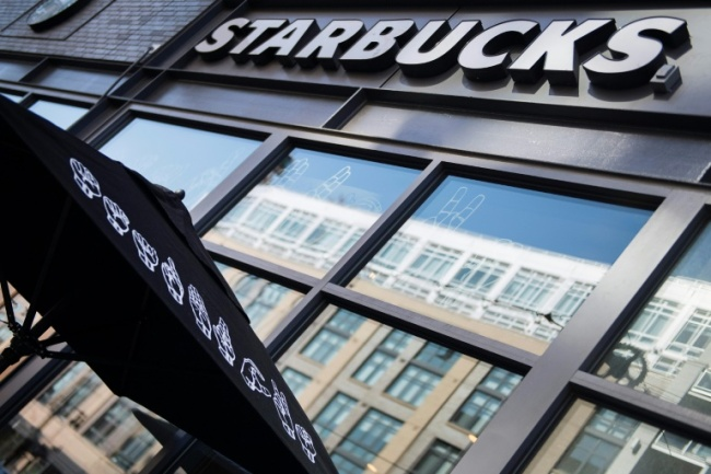 Starbucks is written in sign language on an umbrella outside the new
