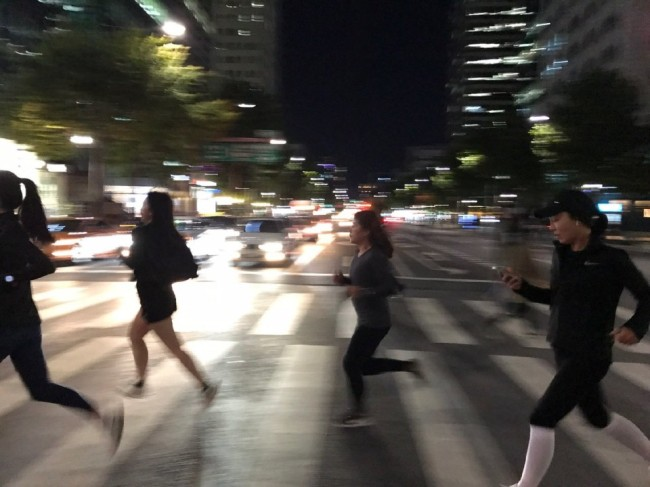 CrewGhost runners dash across a crosswalk.(CrewGhost)