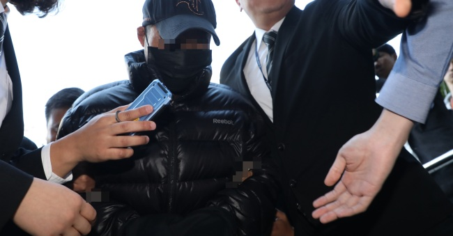 The man who allegedly killed his ex-wife appears for questioning at the Seoul Southern District Court on Thursday. (Yonhap)