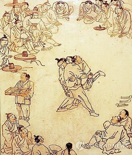 A painting by Joseon-era artist Kim Hong-do depicts ssireum, Korean traditional wrestling. (Yonhap)