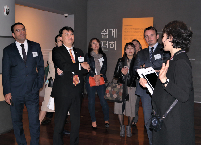 Foreign ambassadors and guests listen to a curator at the National Hangeul Museum in Seoul on Oct. 23, organized as part of CQ Forum by Corea Image Communication Institute. (CICI)