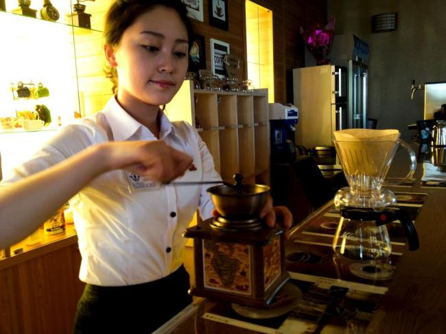 A North Korean staff prepares a coffee at a cafe in central Pyongyang in this Aug. 31, 2013 handout. (Reuters)