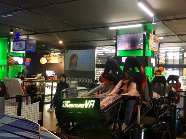 Children enjoy a VR roller coaster ride at the Kong VR theme park at Lotte World Mall in eastern Seoul. (Im Eun-byel/The Korea Herald)