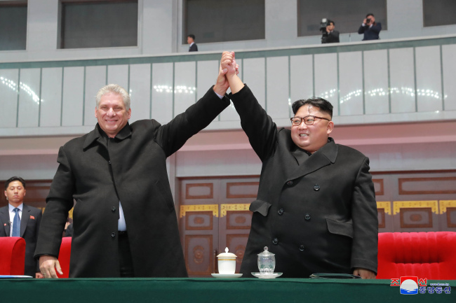 North Korean leader Kim Jong-un (right) and Cuban President Miguel Diaz-Canel watches the mass games performance of