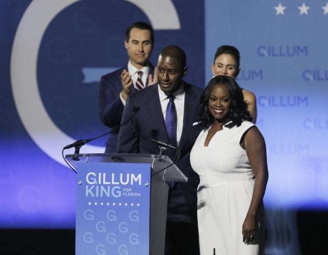 Florida Gubernatorial Democratic candidate Mayor Andrew Gillum gives his concession speech along side his wife First Lady R. Jai Gillum, running mate Chris King and his wife Kristen King on the campus Florida A&M University in Tallahassee, Fla., on Tuesday, Nov. 6, 2018. (AP)