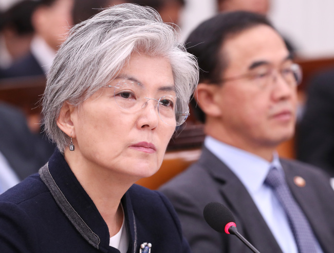 Foreign Minister Kang Kyung-hwa takes questions during a National Assembly session Thursday. (Yonhap)