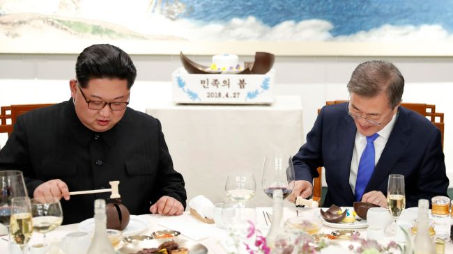 North Korean leader Kim Jong-un, left, and South Korean President Moon Jae-in eat Okryugwan restaurant's signature naengmyon at the truce village of Panmunjom during their summit on April 27. Joint Press Corps
