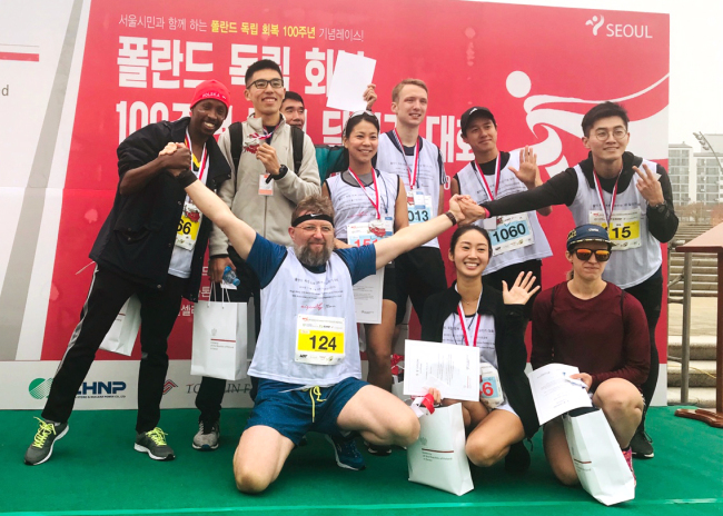 Polish Ambassador to Korea Piotr Ostaszewski (front row, left) poses with the winners of the Polish Independence Run at Ttukseom Hangang Park in Seoul on Sunday. (Polish Embassy)